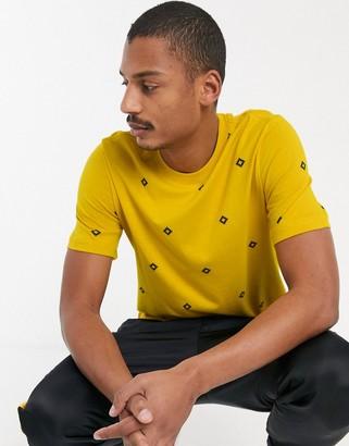 Nike Sb SB all over diamond print t-shirt in yellow