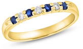 Zales Blue Sapphire and 1/10 CT. T.W. Diamond Seven Stone Wedding Band in 14K Gold
