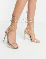 leather tie leg barely there heeled sandals in gold