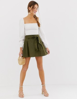 Asos DESIGN tie front mini skirt in cotton