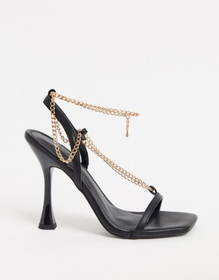 ASOS DESIGN Nia heeled sandals with chain trim in black