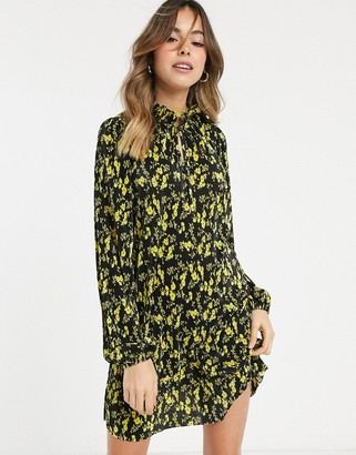 Asos DESIGN plisse smock mini dress with tie neck in black and yellow floral print