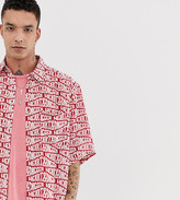 Heart N Dagger all over branded repeat shirt in red