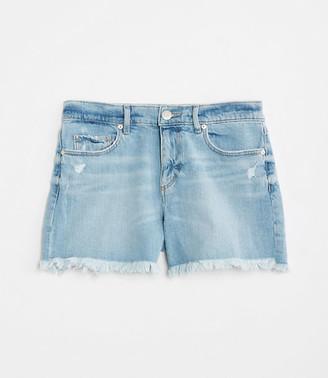 LOFT Petite Destructed Denim Cut Off Shorts in Light Indigo Wash