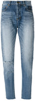 Saint Laurent distressed tapered fit jeans - women - Cotton - 26