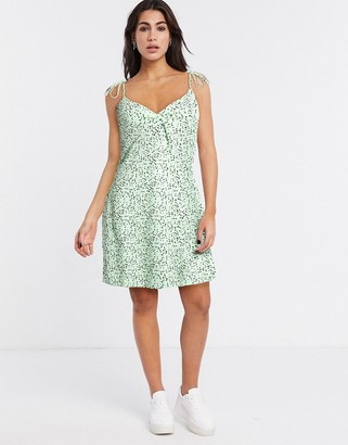 Noisy May swing dress with tie cami sleeves in green polka dot