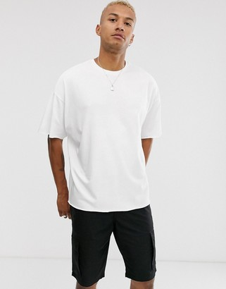Asos DESIGN organic heavyweight oversized crew neck t-shirt with raw edges in white