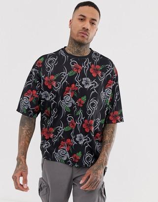 Asos Design DESIGN oversized t-shirt with all over tribal print-Black