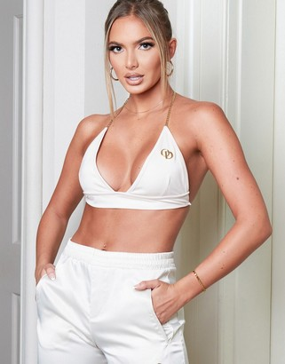 The O Dolls Collection chain detail bikini top with logo detail in cream