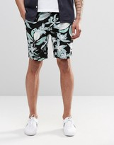 Asos Slim 5 Pocket Shorts In Mid Length With Floral Print