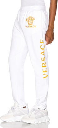 Versace Pants in White & Gold | FWRD