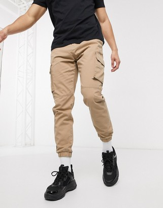 Bershka cargo joggers with belt in beige