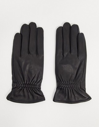 Barneys New York real leather gloves with stretch opening in black