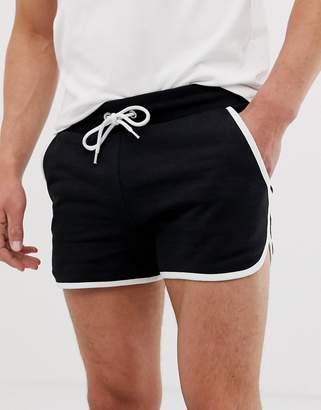 Asos Design DESIGN jersey runner shorts in black