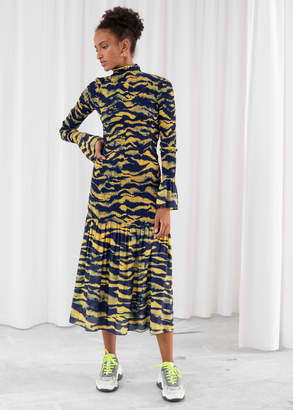 And other stories Tiger Smocked Midi Ruffle Dress