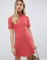 Asos Design DESIGN mini polo shirt dress with large faux horn buttons