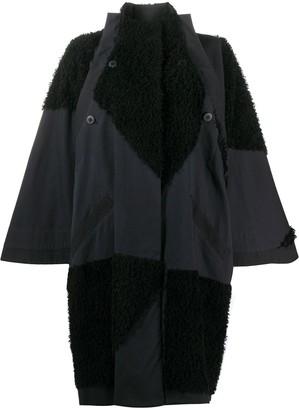 132 5. ISSEY MIYAKE Oversized Shearling Panelled Coat