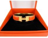 Hermes very good (VG Orange Enamel Gold Clic Clac H Bangle Bracelet