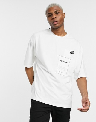 Religion oversized t-shirt with graphic pocket in white