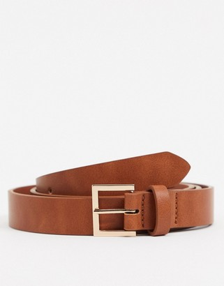 ASOS DESIGN skinny belt in tan faux leather with gold buckle