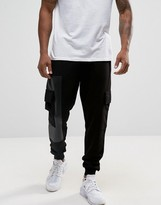 Asos Tapered Joggers With Cargo Pockets And Printed Panels
