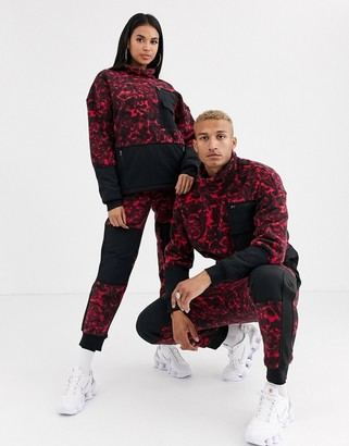 The North Face 94 Rage fleece pant in rose red rage print