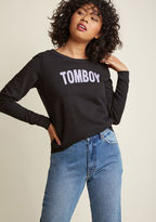 F8022G This black pullover - a ModCloth exclusive - is one stylish way of making character claims! Below a wide neckline, purple letters call out your tendency toward tomboyism, brilliantly broadcasting your truest self for all to see.