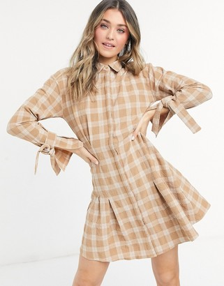 ASOS DESIGN mini shirt dress with tie sleeves and pleated skater skirt in check