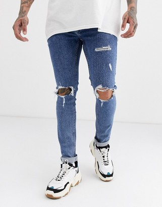 Topman skinny jeans with rips in washed blue