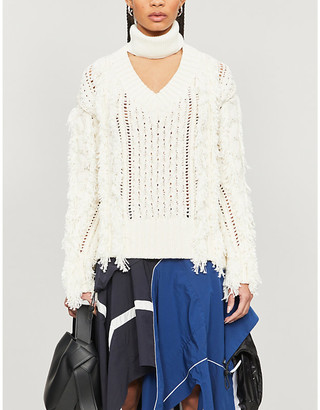 Sacai Fringed turtleneck knitted jumper