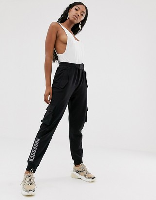 Public Desire utility tracksuit bottoms with obsessed leg print