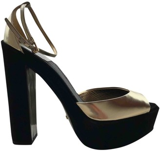 Christian Dior Gold Patent leather Sandals