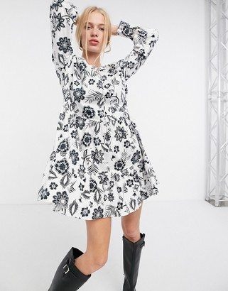 Glamorous mini tiered smock dress with neck tie in black and white floral