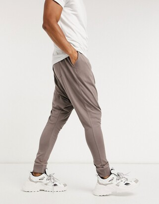 ASOS DESIGN co-ord lightweight extreme drop crotch joggers in brown