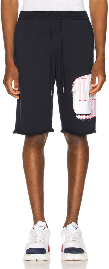 Thom Browne Cut Off Patchwork Sweat Shorts in Navy | FWRD