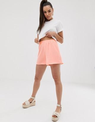 ASOS DESIGN elasticated waist shorts in bright peach