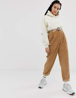 Asos Design DESIGN tapered boyfriend jeans with curved seams in brown diamond cord with plastic belt