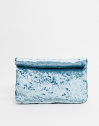 ASOS DESIGN roll top velvet clutch in blue