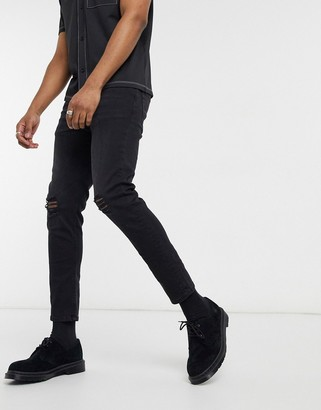 ASOS DESIGN cropped skinny jeans in washed blackwith knee rips