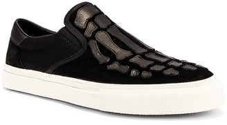 Amiri Skeleton Slip On Sneaker in Black | FWRD