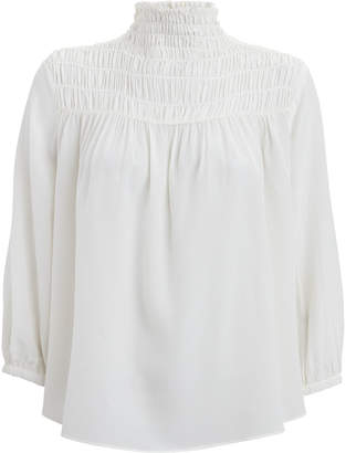 Frame Silk Smocked High-Neck Blouse