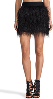 kim kardashian  Who made  Kim Kardashians black feather skirt, blazer, and suede pumps that she wore in Paris?