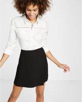 Express asymmetrical wrap mini skirt