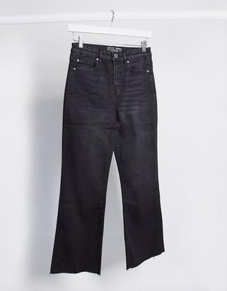 Stradivarius crop flare jeans in black