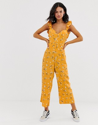 Asos DESIGN jumpsuit with frill strap and tie back in yellow floral print
