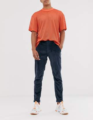 Tommy Jeans tapered cord chinos in navy