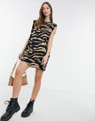 ASOS DESIGN padded shoulder sleeveless mini dress in camel zebra print