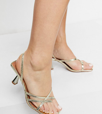 ASOS DESIGN Wide Fit Whirl strappy toe thong mid heeled sandals in gold