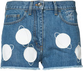 Courreges planet patch denim shorts - women - Cotton/Lamb Skin - 36