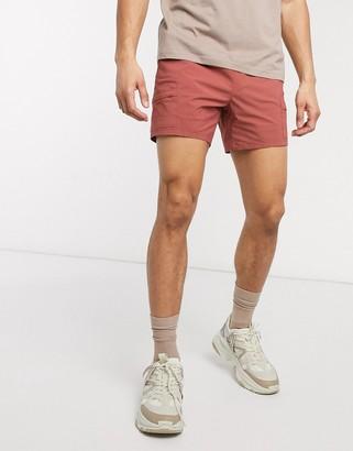 ASOS DESIGN slim shorts in red nylon